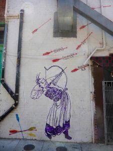 Eines der Wandbilder, hier Teil 1: Kinder chinesischer Immigranten malten es. Es zeigt, wie sie aus der Heimat weggingen, auf den abgeschossenen Pfeilen steht z.B. Freiheit oder Vertrauen.